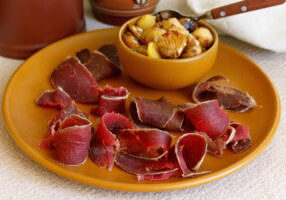 thinly sliced cured venison