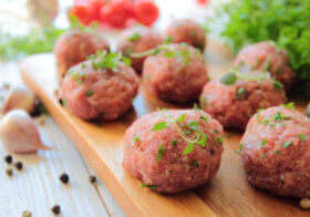Fresh raw meatballs with herbs